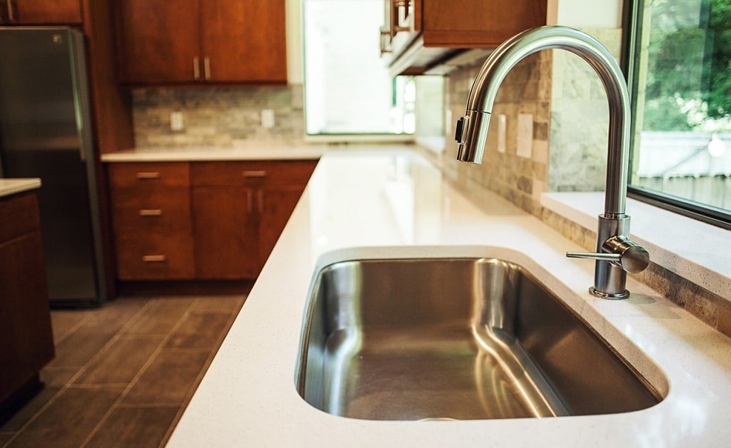 White kitchen countertops in an updated kitchen