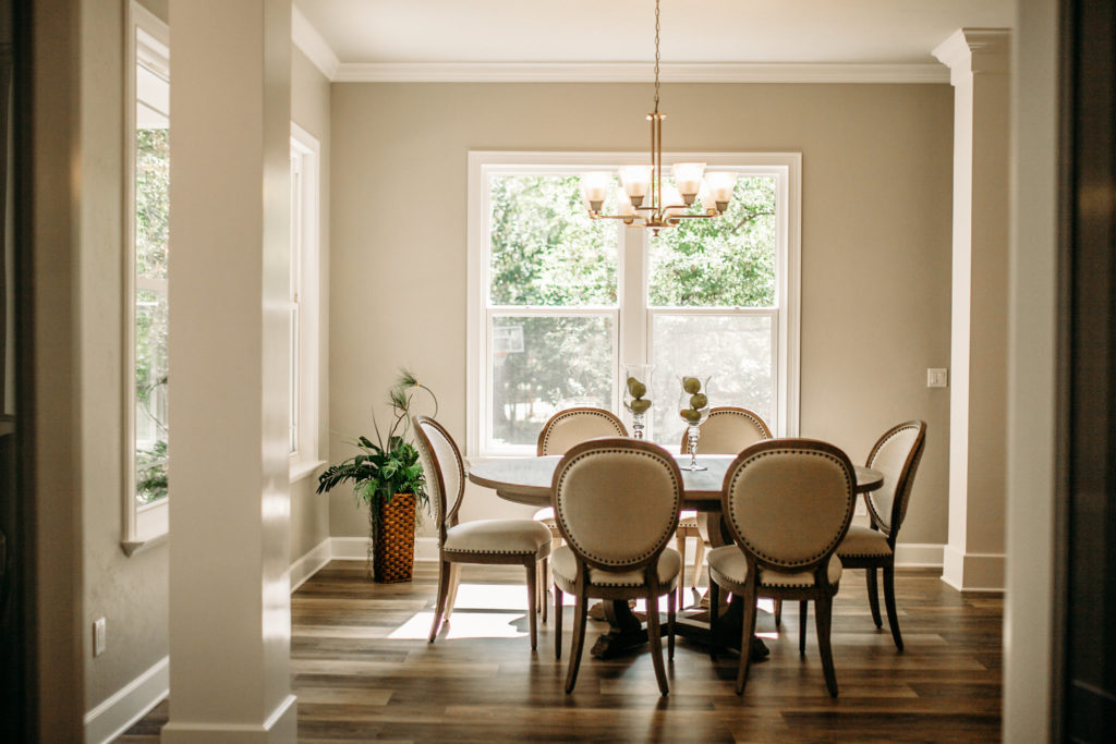 dining room with table and chairs in front of sunny window