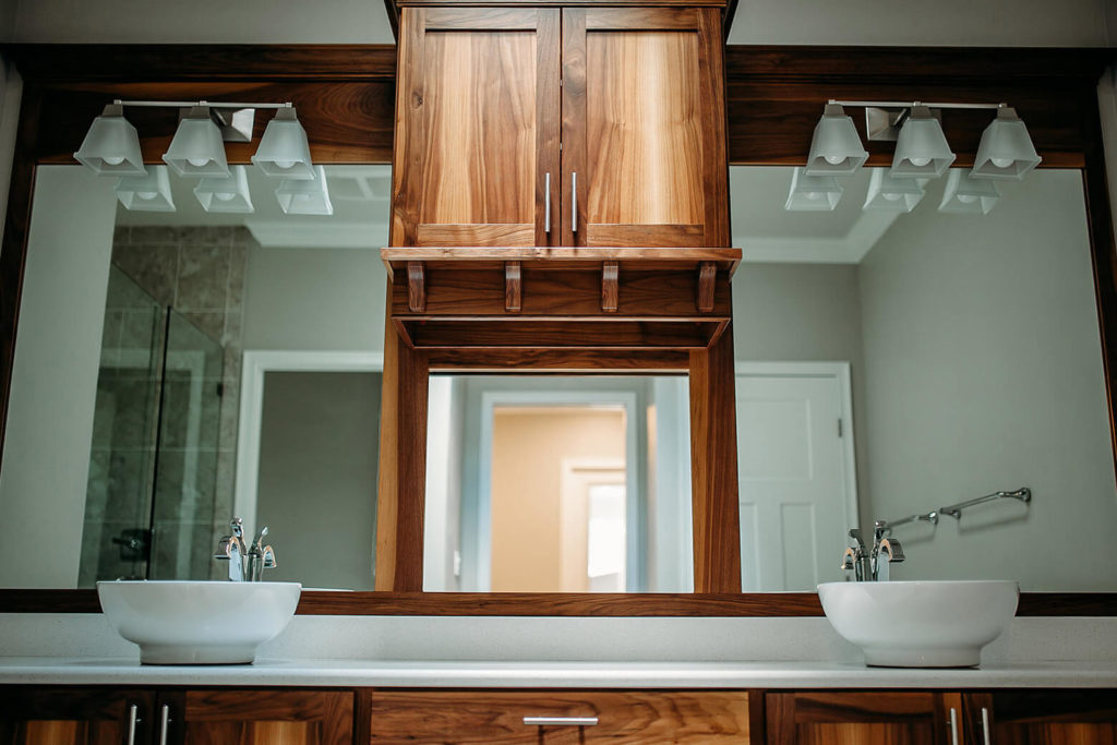 Wooden bathroom vanity with double sinks