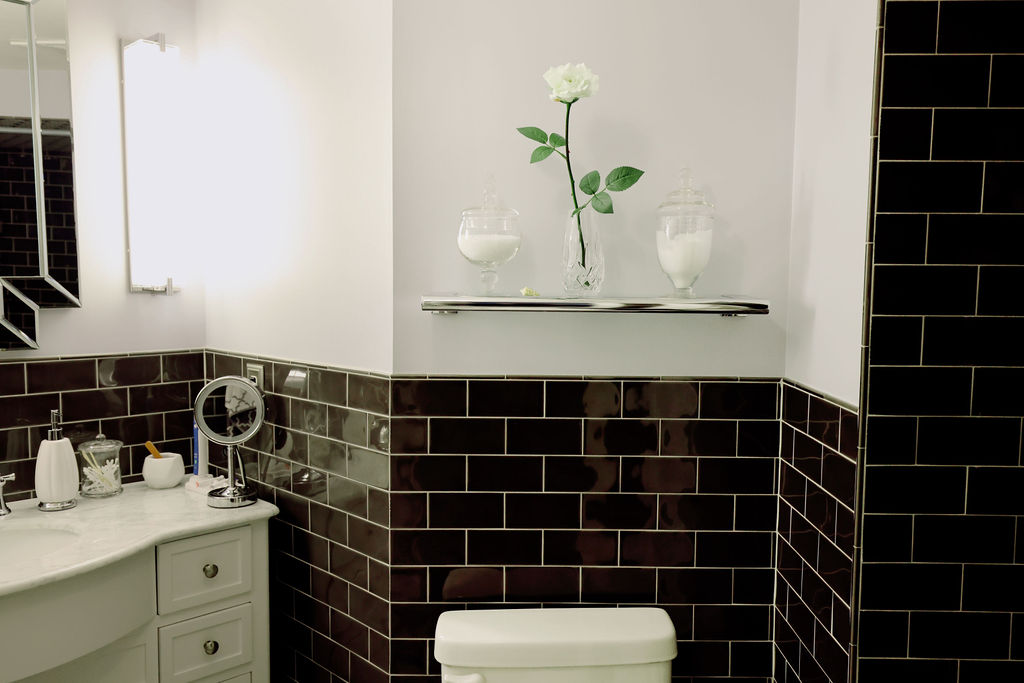 Bathroom with a black and white decor theme