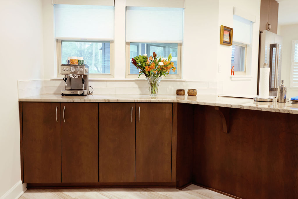 Kitchen with dark wood cabinets and white walls