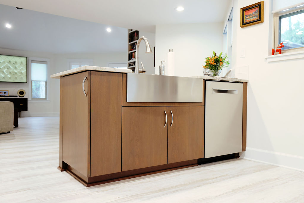 Residential kitchen with stainless steal appliances and wood cabinets
